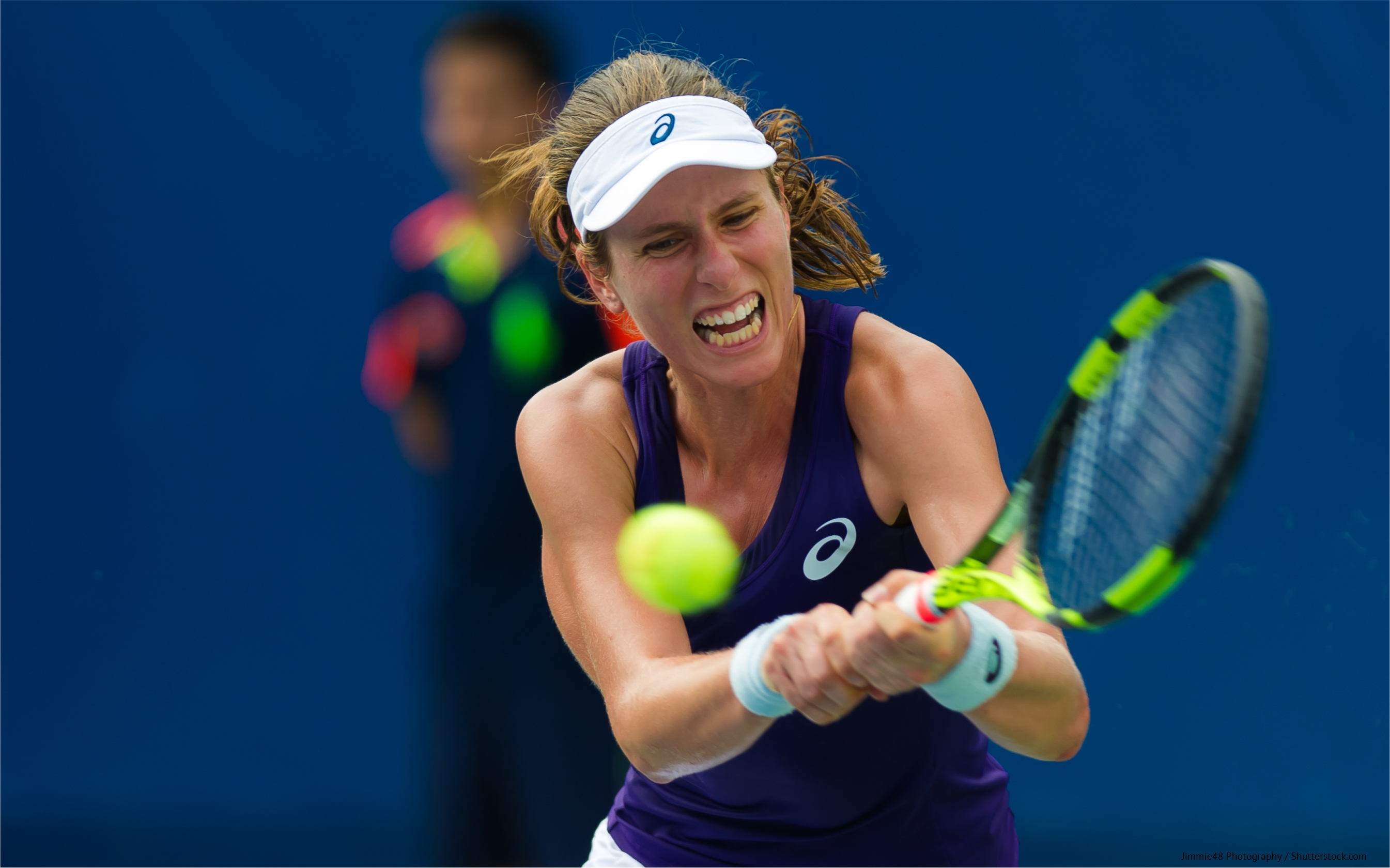 Johanna Konta trying to hit a tennis ball